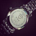 Grawerowanie laserowe na wieczku zegarka marki Tissot